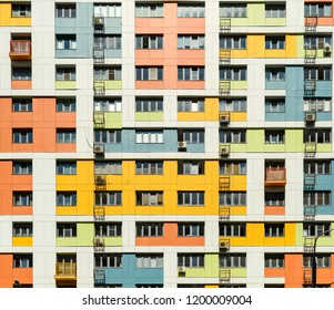 Front flat view to modern design colorful residential multi-storey building