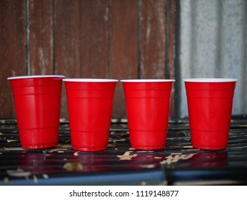 Front of four red cups