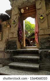 the front gate of the houses of the traditional village of Tenganan Pegringsingan, Bali. There is a typical gringsing woven hanging in the gate.