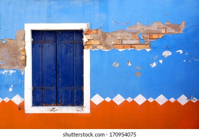 front of a house painted in traditional patterns and colors