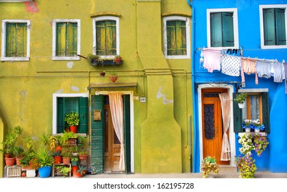 front of houses in a street painted in bright colors