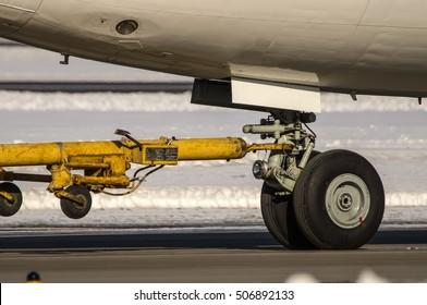 Front landing gear of big passenger aircraft closeup high detailed view