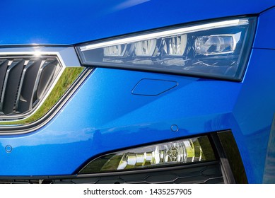 Front lights of a blue car