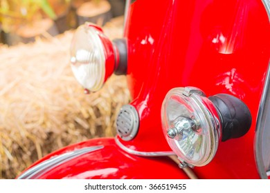 Front lights of a red motorbike.