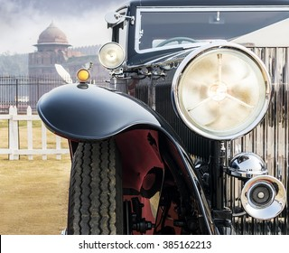 Front low angle view of oldtimer vintage saloon car. The front lights and chrome grill of classic beauty looking solid yet elegant and attractive.