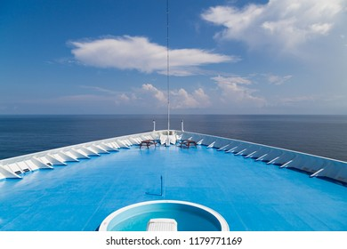 Front of luxurious cruise ship deck over looking ocean horizon