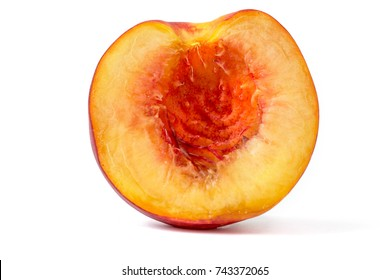 Front macro view of appetizing half peach as a wallpaper