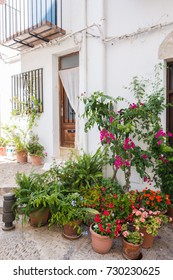 Front of Mediterranean house with pots flowers