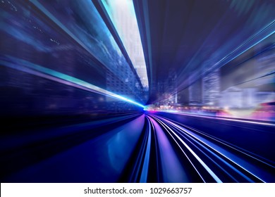 In front of moving train on city