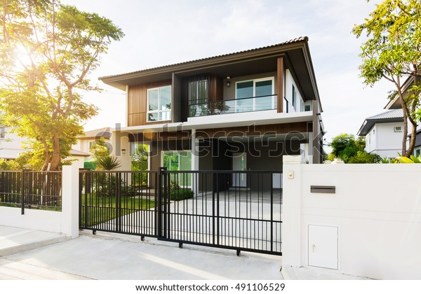 front of new house for sale during at sunrise in summer