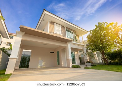 Front of New Residential house for sale with blue sky during at sunrise.Home For Sale,Rent,Housing and Real Estate concept.