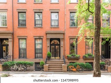 The front of an ornate brownstone building in an iconic neighborhood of Brooklyn Heights in New York City