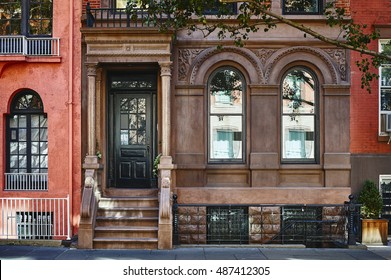 The front of an ornate brownstone building in an iconic neighborhood of Manhattan, New York City.