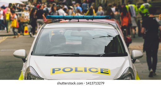 Front of parked Police Car, Walking People in Blurred Background, Shallow Depth of Field, Bristol England 2019