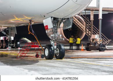 The front of the passenger plane and landing gear close up. Aircraft maintenance before flight.