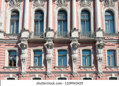 Front picture of beautiful wall with sculptures between the windows in St. Petersburg, Russia