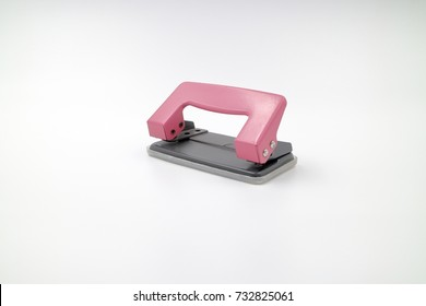 front of pink paper punch. isolate background