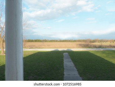 Front Porch of Farmhouse in Southern Missouri Country with Farm Pasture Acreage