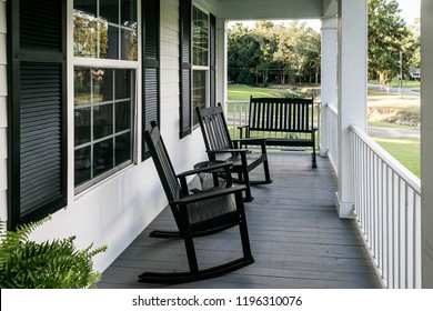 Front Porch of Southern home with Black Rocking Chairs and a Casual Feel