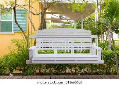 Front porch with a white porch swing,relax corner