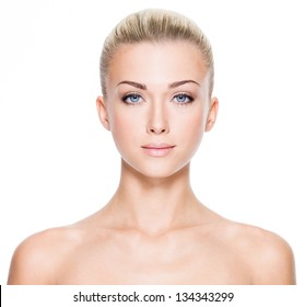 Front portrait of beautiful young woman with beautiful blue eyes and face - on white background