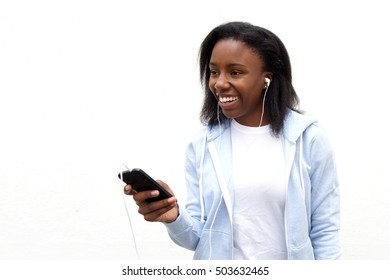 Front portrait of happy african woman listening music on smartphone.
