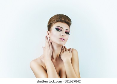 Front portrait of a nude girl with beautiful make-up and arms coverd.