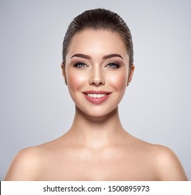Front portrait of the smiling woman with beauty face - isolated. Beauty face of the young beautiful girl  with a  healthy skin. Cheerful female with a beautiful eyes. Skin care concept.