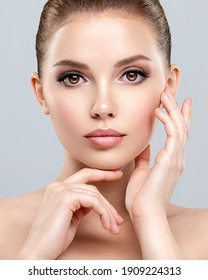 Front portrait of a white young woman with beauty face - isolated. Skin care concept. Young adult  caucasian girl with a clean skin.