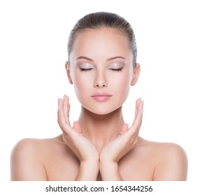 Front portrait of young beautiful woman  with  hands at  face with closed eyes - isolated on white background. Skin care concept.
