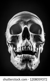 Front of real skull in abstract smoke isolated on black background.