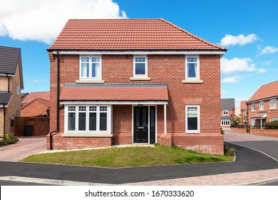 Front of red brick detached house