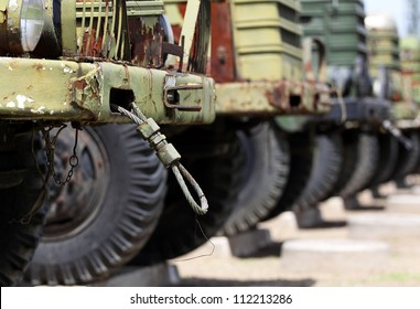 Front of a row military vehicles