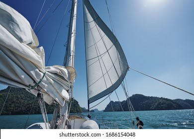 front sail blow by wind with islands view