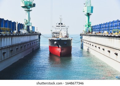 front ship moored in the sea during bring cargo ship go to repair in floating dry dock for maintenance, repair in shipyard.