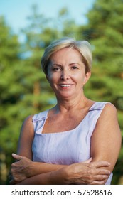 Front shot of cheerful mature woman