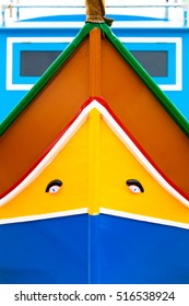 Front side of traditional yellow-blue maltese fisherman boat.