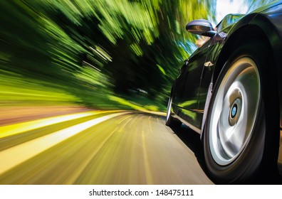 Front side view of black car with heavy blurred motion.