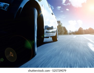 Front side view of the black car driving fast