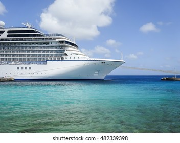 Front side view of luxury cruise ship. Cruise liner docked in Caribbean port.