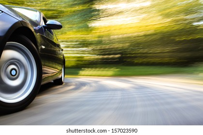 Front side view of luxury sedan in turn.