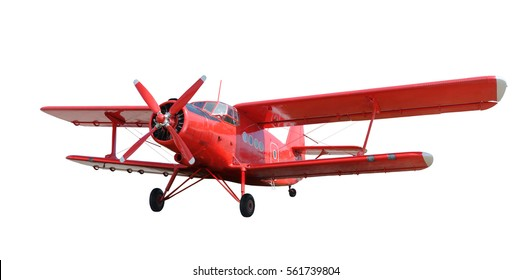 Front side view of red airplane biplane with piston engine and propeller. Isolated on white background