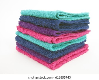 Front and side view of stacked washcloths. Isolated.