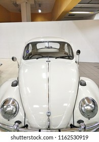Front side of white Volkswagen (VW) beetle classic car on display atshowroom parked for sale.August 23,2018 : Chiang Mai, Thailand.