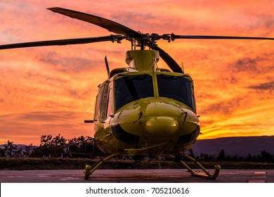 A front side wildfire helicopter view on a spectacular sunset