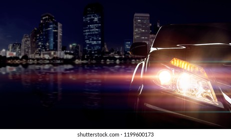 Front of a sport car on city background