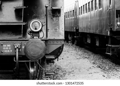 Front of a Steam Locomotive, Bumper, Buffer, Lampfs, Railroad Car in Background, Black and White