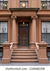 front steps to New York brownstone style apartment building