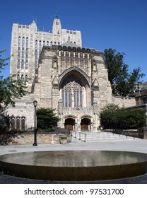 The front of Sterling Memorial Library at Yale University in New Haven, CT, with The Women's Table by Maya Lin in the foreground