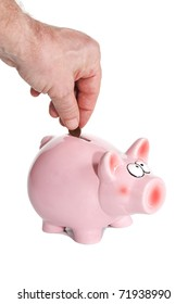 A front studio isolation shot on a white background of a penny being dropped into a pink ceramic piggy bank.